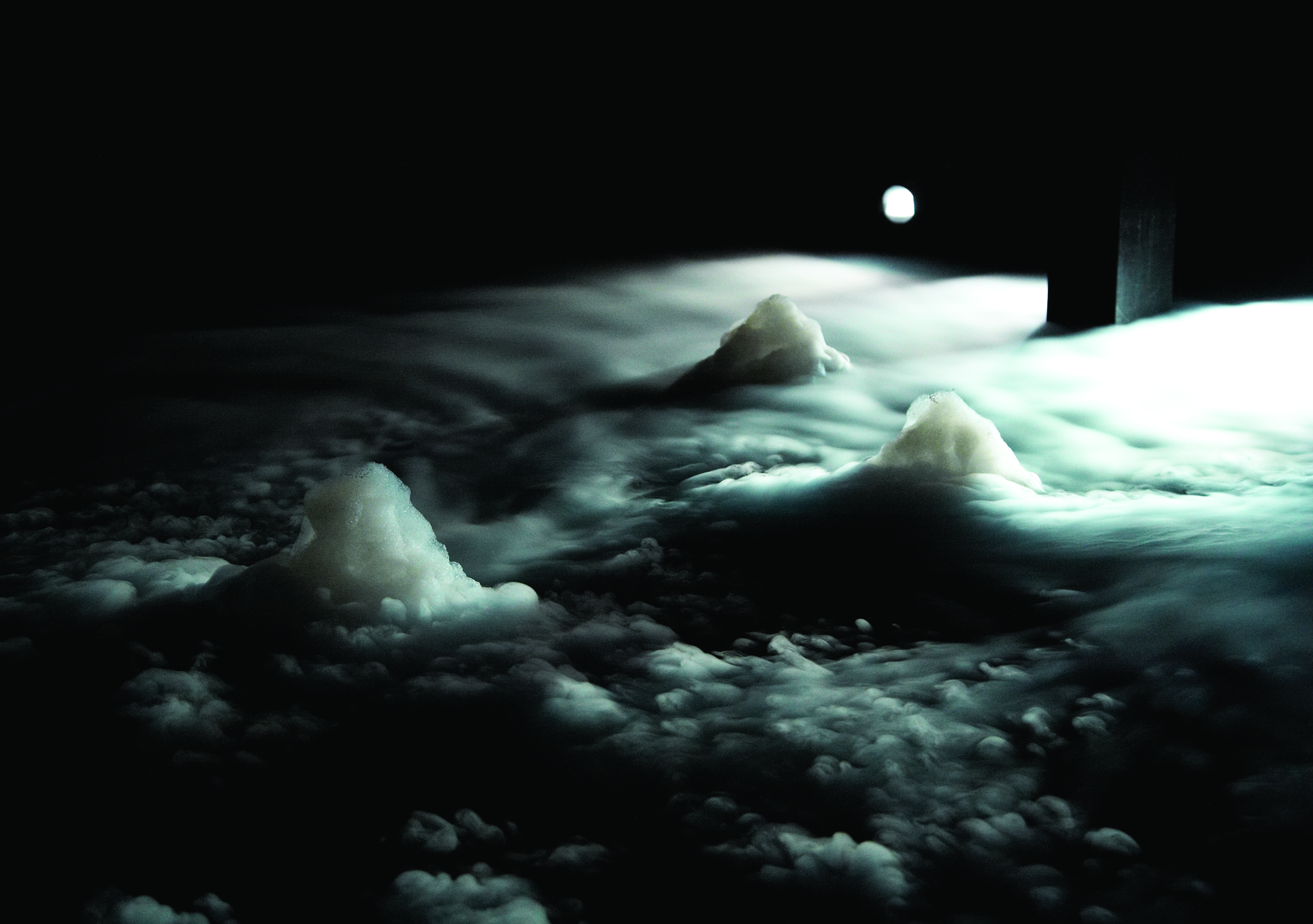 image of cloudy backlit landscape at night, from Mette ingvartsen's Evaporated Landscapes project.